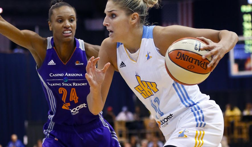 FILE - In this Sept. 12, 2014, file photo, Chicago Sky forward Elena Delle Donne, right, goes to the basket past Phoenix Mercury forward DeWanna Bonner (24), during the second half of Game 3 of the WNBA Finals in Chicago. The third-year star is the key to Chicago's success this season. (AP Photo/Kamil Krzaczynski, File)