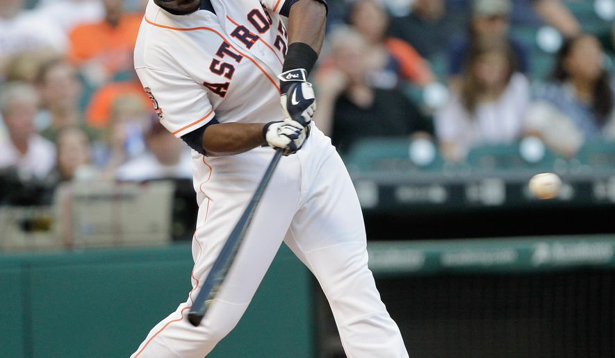 Houston Astros' Chris Carter (23) hits a home run against the Baltimore Orioles during the second inning of a baseball game Wednesday, June 3, 2015 in Houston. (AP Photo/Bob Levey)