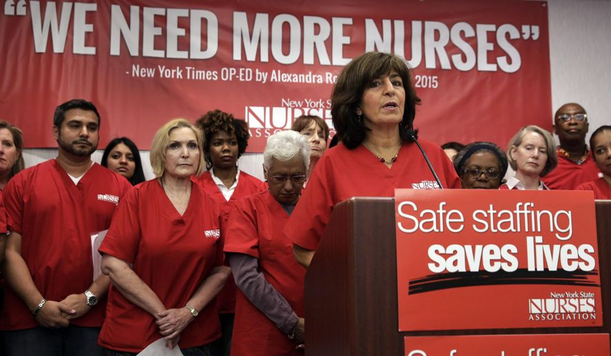 President Judy Sheridan-Gonzalez, at podium, of the New York State Nurses Association, addresses a news conference, in New York, Wednesday, June 3, 2015. The union representing more than 18,000 registered nurses at 14 of New York City's private hospitals says members have voted to authorize a strike if contract negotiations aren't carried out in good faith. The New York State Nurses Association says the main issue for its members is staffing level at the hospitals. (AP Photo/Richard Drew)