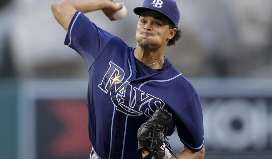 Tampa Bay Rays starting pitcher Chris Archer throws against the Los Angeles Angels during the first inning of a baseball game, Tuesday, June 2, 2015, in Anaheim, Calif. (AP Photo/Jae C. Hong)