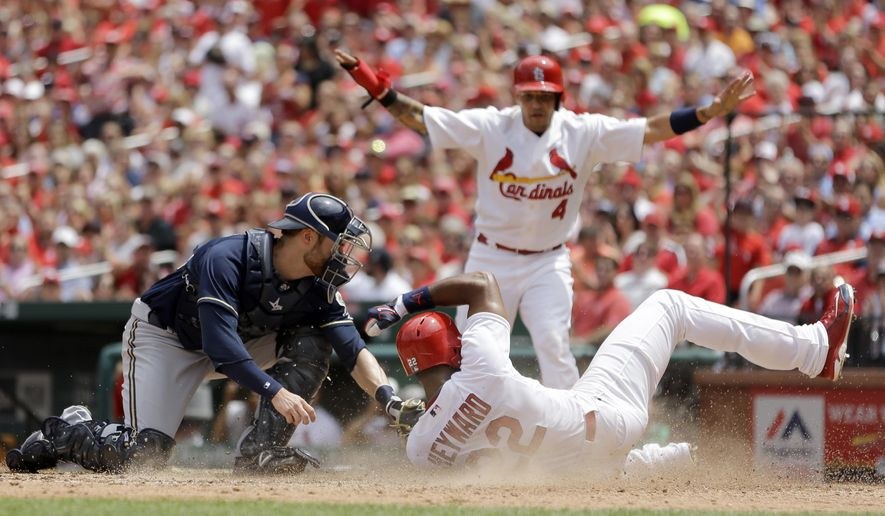 St. Louis Cardinals' Jason Heyward, right, is safe as he scores ahead of the tag from Milwaukee Brewers catcher Jonathan Lucroy, left, and Cardinals Yadier Molina watches in the background during the fourth inning of a baseball game, Wednesday, June 3, 2015, in St. Louis. (AP Photo/Jeff Roberson)