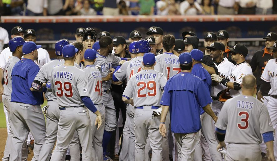 Players rush the field after Chicago Cubs' Junior Lake and Miami Marlins catcher J.T. Realmuto exchanged words after Lake hit a home run scoring Anthony Rizzo during the sixth inning of a baseball game, Wednesday, June 3, 2015, in Miami. (AP Photo/Wilfredo Lee)