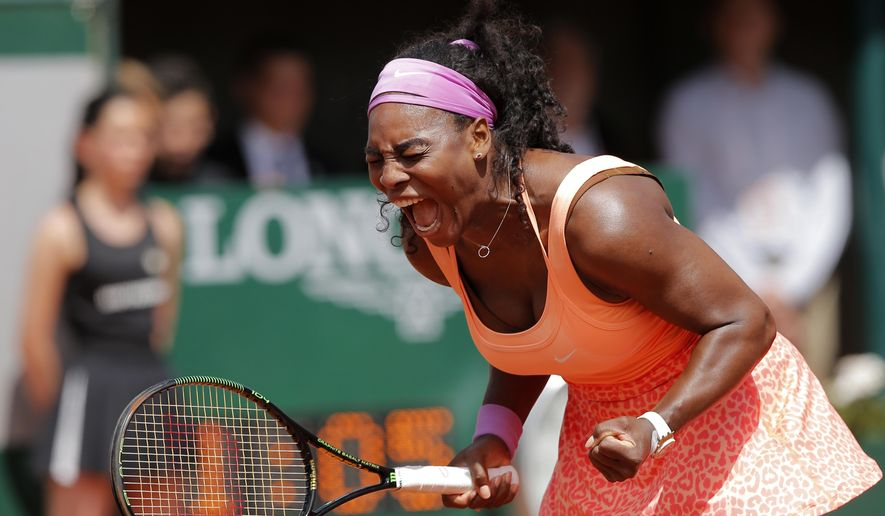 Serena Williams of the U.S. screams as she defeats Italy's Sara Errani in the quarterfinal match of the French Open tennis tournament in two sets 6-1, 6-3, at the Roland Garros stadium, in Paris, France, Wednesday, June 3, 2015. (AP Photo/Christophe Ena)