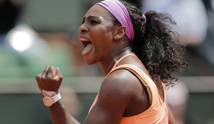 Serena Williams of the U.S. clenches her fist after scoring a point in the quarterfinal match of the French Open tennis tournament against Italy's Sara Errani at the Roland Garros stadium, in Paris, France, Wednesday, June 3, 2015. (AP Photo/Christophe Ena)