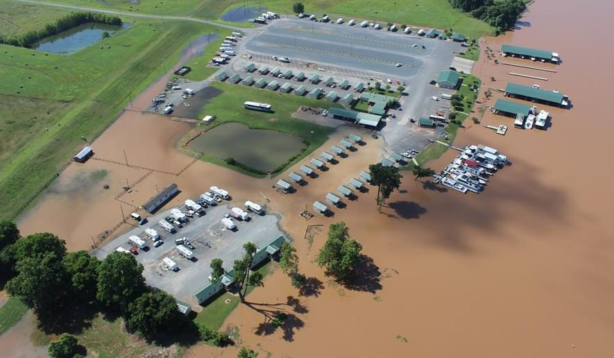 In this Tuesday, June 2, 2015, photo provided by the Bossier Sheriff's Office, the Red River rises at the Red River South Marina in Bossier City, La. The river has reached its 30-foot flood stage for the first time since 1990 as floodwaters drain from Oklahoma and Texas. (Dave Faulk/Bossier Sheriff's Office via AP)