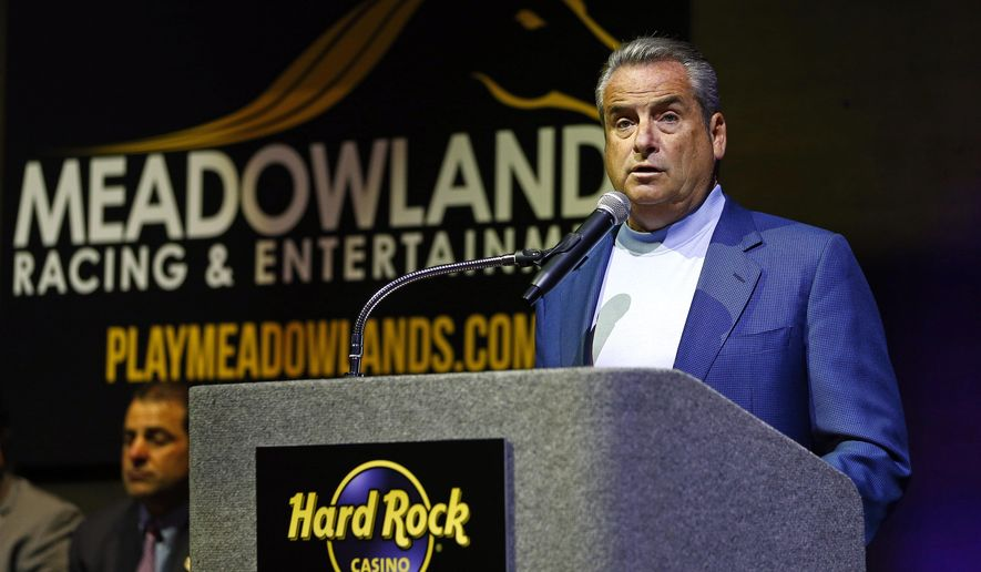Jim Allen, chairman of Hard Rock International, talks about plans for Hard Rock and Meadowlands Racing & Entertainment as they unveil the future plans for Hard Rock Casino Meadowlands at the Meadowlands Racetrack in East Rutherford, N.J. Wednesday, June 3, 2015. (AP Photo/Rich Schultz)