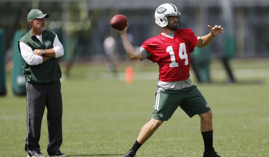 New York Jets quarterback Ryan Fitzpatrick, right, throws as offensive coordinator Chan Gailey looks on during organized team activities at the team's NFL football training center, Wednesday, June 3, 2015, in Florham Park, N.J. (AP Photo/Julio Cortez)