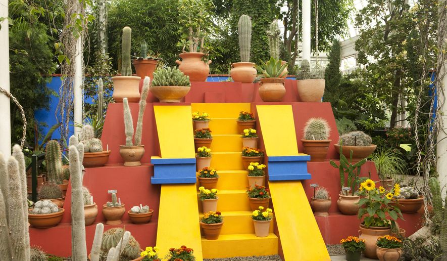 """This 2015 photo provided by The New York Botanical Garden shows cactuses, colors and textures of Frida Kahlo's Mexico on display at the """"Frida Kahlo: Art, Garden, Life"""" exhibit at The New York Botanical Garden in Bronx, N.Y. The show runs May 16 through Nov. 1, 2015.  (Ivo M. Vermeulen/The New York Botanical Garden via AP)"""