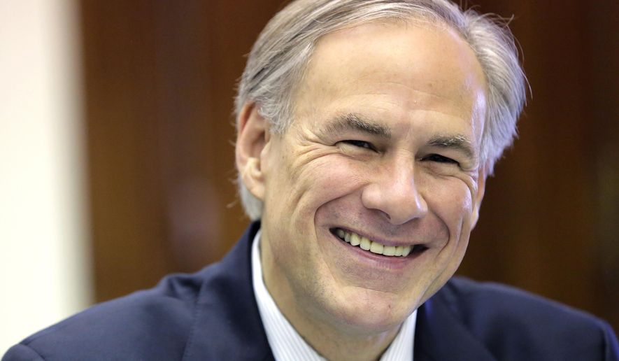 Texas Gov. Greg Abbott shares a laugh with news reporters during a round table talk in his office at the Texas Capitol, Wednesday, June 3, 2015, in Austin. (AP Photo/Eric Gay)
