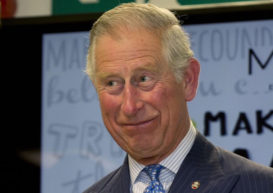 Britain's Prince Charles smiles as he hands out certificates to Prince's Trust 'Mark your Mark participants during a visit to British retailer Marks and Spencer in London on May 13, 2015. (Associated Press) **FILE**