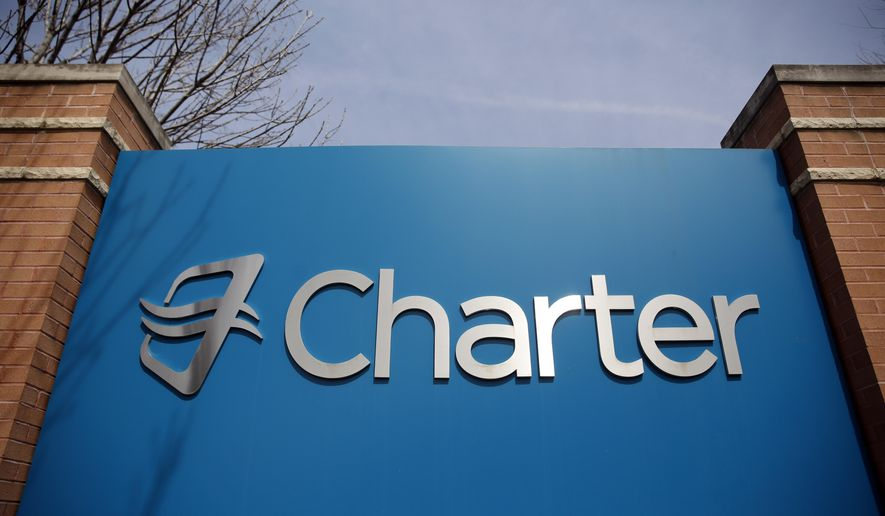 This April 1, 2015 photo shows an entrance to Charter Communications' headquarters in Town and Country, Mo. Charter will renegotiate this bid and combine it with a deal for Time Warner Cable in May. (AP Photo/Jeff Roberson)