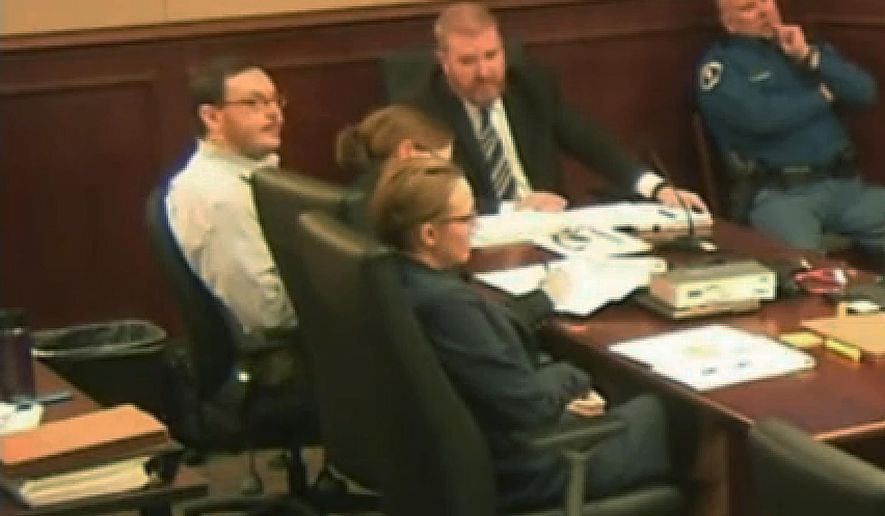 File - In this April 27, 2015 file photo taken from video, Colorado movie theater shooter James Holmes, far left, sits with his defense team during his trial at the Arapahoe County Justice Center, in Centennial, Colo. Homes trial Judge Carlos Samour rejected defense attorneys' second request for a mistrial Wednesday, June 3, 2015, over video shown in court of a psychiatrist's interview with Holmes. (Colorado Judicial Department via AP, Pool, file)