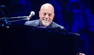 FILE - In this May 9, 2014 file photo, singer Billy Joel performs at Madison Square Garden in New York. Joel is about to prove he's the top piano man at Madison Square Garden by beating Elton John's record for the most performances at the famous New York City arena. Elton John has played 64 shows at the Garden. Joel is poised to tie that record this month, and on July 1, 2015, would surpass him at 65 shows. (Photo by Scott Roth/Invision/AP, File)