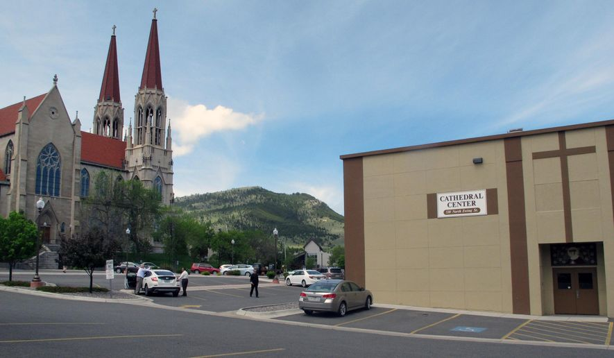 The offices of the Roman Catholic Diocese of Helena and the Cathedral of St. Helena are shown in Helena, Mont., Thursday,  June 4, 2015. The diocese recently released a list of child sexual predators that included a priest who was believed murdered but whose disappearance was never solved. (AP Photo/Matt Volz)