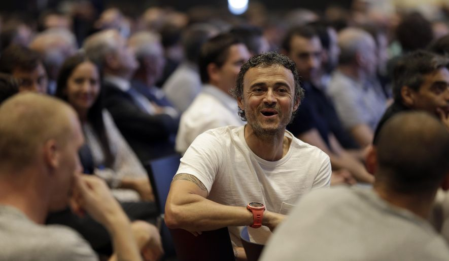 FC Barcelona coach Luis Enrique smiles during Xavi Hernandez's farewell event at the Camp Nou stadium in Barcelona, Spain, Wednesday, June 3, 2015. FC Barcelona midfielder Xavi Hernandez says he will leave the Catalan club after 17 trophy-laden seasons in which he set club records for appearances and titles won. The 35-year-old Xavi says he will cut his contract short by one year and leave after this season to go play for Qatari club Al-Sadd on a two-year contract. (AP Photo/Manu Fernandez)