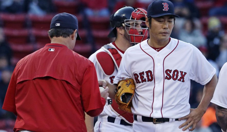 Boston Red Sox relief pitcher Koji Uehara hands the baseball to manager John Farrell as he is taken out in the ninth inning of a baseball game against the Minnesota Twins at Fenway Park on Thursday, June 4, 2015, in Boston. Uehara gave up four runs, with the game tied 4-4, without notching an out. (AP Photo/Charles Krupa)