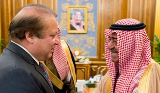 Saudi Arabia's Salman bin Abdul Aziz Al Saud shakes hands with Pakistani Prime Minister Nawaz Sharif in Riyadh, Saudi Arabia. A Pakistan envoy said his nation is eager for the U.S. to reach a nuclear accord with Iran so sanctions on Tehran can be lifted, but denied charges that Islamabad might provide nuclear weapons to Saudi Arabia (Associated Press)