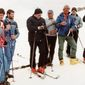 Pope John Paul II (center, in red boots) prays with a group of skiers before heading down a slope in this 1984 file photo. (CNS photo from the Vatican) (Feb. 10, 2005)