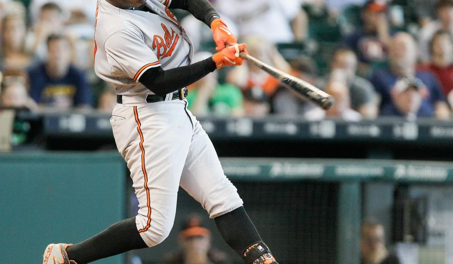 Baltimore Orioles' Adam Jones hits a home run in the eighth inning of a baseball game against the Houston Astros, Thursday, June 4, 2015 in Houston. (AP Photo/Bob Levey)