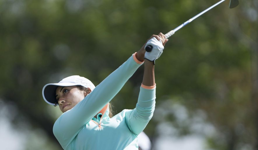 Cheyenne Woods hits her tee shot on the 13th hole during the first round of the Manulife LPGA Classic golf tournament, Thursday, June 4, 2015, in Cambridge, Ontario. (Peter Power/The Canadian Press via AP)
