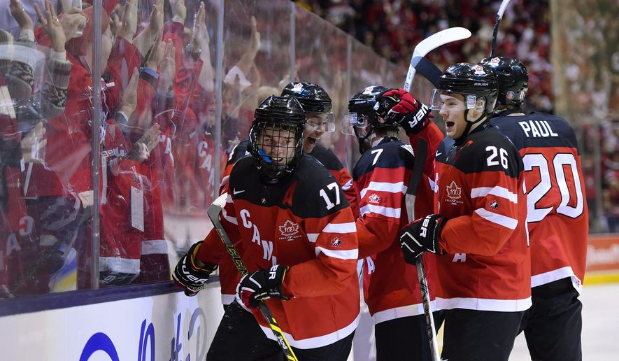 FILE - In this January, 2015 file photo, Canada's Connor McDavid (17) celebrates his second-period goal against Russia during the title game at the hockey World Junior Championship in Toronto. Though he's yet to be drafted, McDavid has landed his first major sponsorship deal with CCM Hockey. (AP Photo/The Canadian Press, Frank Gunn, File)