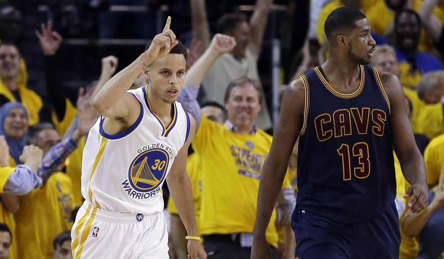 Golden State Warriors guard Stephen Curry (30) reacts after scoring in front of Cleveland Cavaliers center Tristan Thompson (13) during the first half of Game 1 of the NBA Finals on Thursday in Oakland, Calif. (Associated Press)