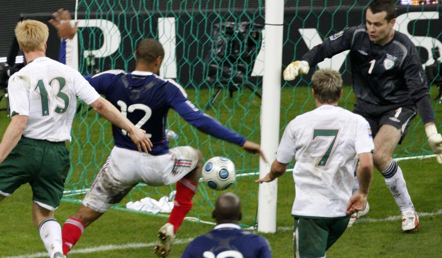 File - France's Thierry Henry, left, passes the ball as Ireland's goalkeeper Shay Given, right, tries to stop it, just before William Gallas (unseen) scored the goal for France during their World Cup qualifying playoff second leg soccer match at the Stade de France stadium in Saint Denis outside Paris, Wednesday, Nov. 18, 2009.  FIFA has admitted to giving Ireland $5 million in compensation for missing out on a place at the 2010 World Cup after Thierry Henry's handball that set up the French winner. The payment _ initially a loan _ was not disclosed in the wake of the 2009 playoff game, which France won 2-1 on aggregate to reach the finals in South Africa. The cash from FIFA was first disclosed in public on Thursday June 4 2015 by Football Association of Ireland chief executive John Delaney, who didn't say it was a loan. (AP Photo / Michel Euler, file)
