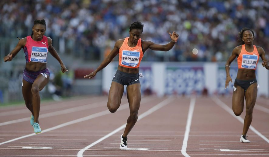 US Jeneba Tarmoh, center, competes alongside Bahamas' Anthonique Strachan, left, and Britain's Bianca Williams to win the women's 200m event, event at the Golden Gala IAAF athletic meeting, at Rome's Olympic stadium, Thursday, June 4, 2015. (AP Photo/Andrew Medichini)