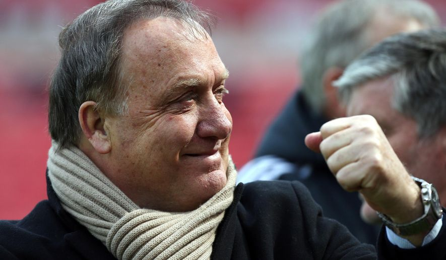 FILE - In this Saturday May 2, 2015 file photo, Sunderland's manager Dick Advocaat awaits the start of the English Premier League soccer match between Sunderland and Southampton at the Stadium of Light, Sunderland, England. Dick Advocaat has signed a one-year deal as Sunderland manager, Thursday June 4, 2015, a week after saying he would not be continuing at the club after securing its Premier League status last season as an interim coach. (AP Photo/Scott Heppell, File)