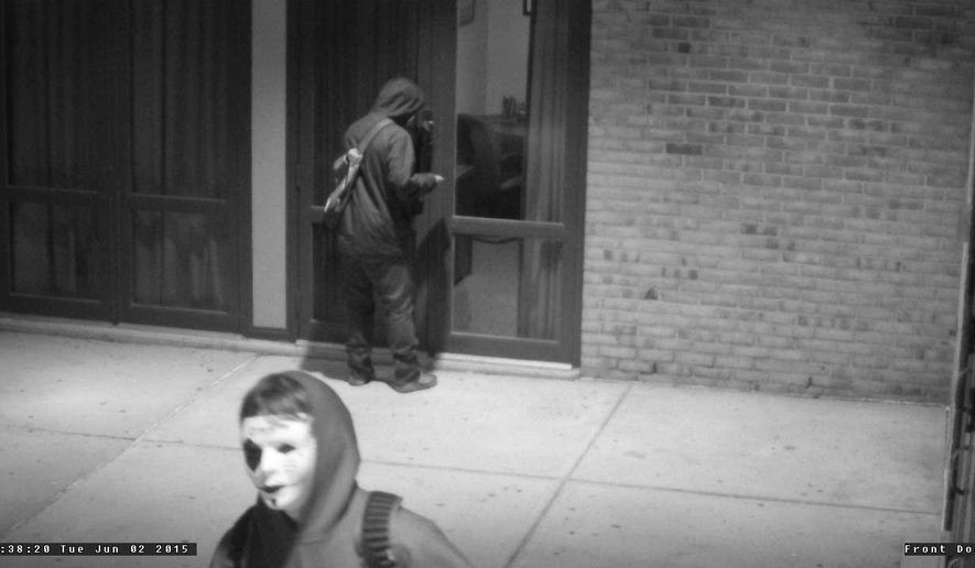 This photo taken from surveillance video provided by Anne Arundel County police shows vandals outside the Chesapeake High School on Tuesday, June 2, 2015 in Pasadena, Md.  Roughly 12 hours after the senior class graduated Tuesday, county police say vandals returned to the school and caused significant property damage. Police spokesman Lt. Glenn Shanahan says police believe it was a senior prank. Schools spokesman Bob Mosier says the vandalism caused $2,000 in damages. (Anne Arundel County police via AP)