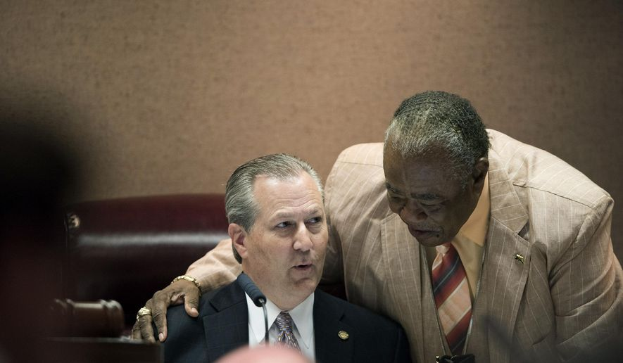 Speaker of the House Mike Hubbard, left, speaks to Representative John Rogers, D-Birmingham, during the legislative session on Thursday, June 4, 2015, at the State House in Montgomery, Ala. (Albert Cesare/The Montgomery Advertiser via AP)  NO SALES; MANDATORY CREDIT