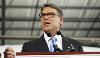 Former Texas Gov. Rick Perry speaks to supporters to announced the launch of his presidential campaign for the 2016 elections, Thursday, June 4, 2015, in Addison, Texas. (AP Photo/Tim Sharp)