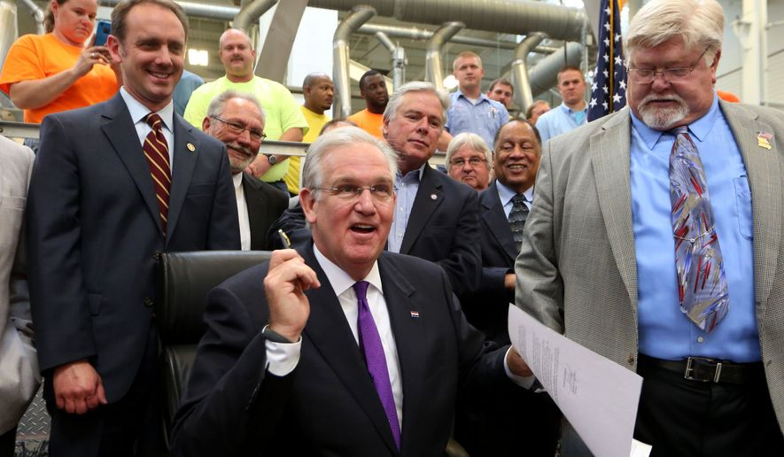 "Missouri Gov. Jay Nixon signs a ceremonial veto of the controversial ""right-to-work"" legislation on Thursday, June 4, 2015, at the Sheet Metal Workers Local 36 training facility in St. Louis. The actual veto was signed earlier in the day in Jefferson City. (Laurie Skrivan/St. Louis Post-Dispatch via AP)  EDWARDSVILLE INTELLIGENCER OUT; THE ALTON TELEGRAPH OUT; MANDATORY CREDIT"