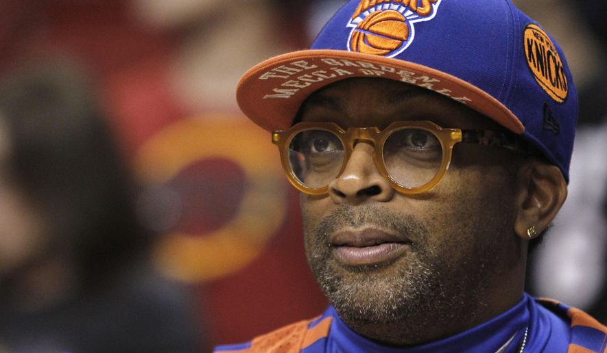 "FILE - In this Feb. 27, 2011, file photo, film director Spike Lee watches practice before an NBA basketball game between the New York Knicks and Miami Heat in Miami. ""NBA 2K16"" will be a Spike Lee joint. 2K Games announced Thursday, June 4, 2015, that it recruited the die-hard NBA fan and acclaimed filmmaker to write, direct and produce the single-player campaign for the next edition of the interactive basketball series. (AP Photo/Alan Diaz, File)"