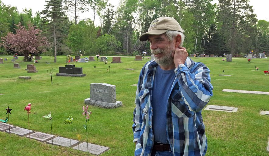 ADVANCED FOR RELEASE SATURDAY, JUNE 6, 2015 Larry Pederson digs about 8 graves a year, many at Olivet Cemetery on the outskirts of Deer River, Minn., where he was on May 27, 2015. Funeral homes pay him $500 per grave, and $700 in the winter. It's good money for a night's work in northern Minnesota -- which is what got him started digging in the first place. (John Enger/Minnesota Public Radio News via AP) MANDATORY CREDIT
