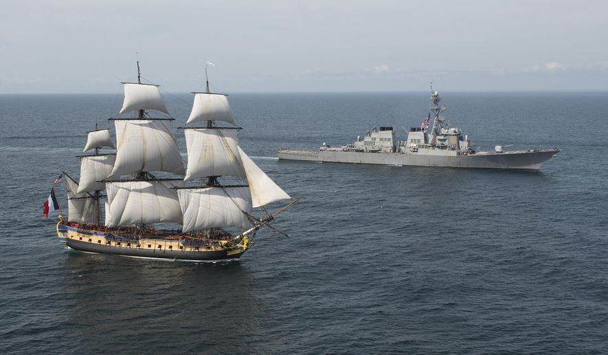 In this Tuesday, June 2, 2015 image provided by the U.S. Navy, the Arleigh Burke-class guided-missile destroyer USS Mitscher, right, welcomes the French tall ship replica Hermione in the vicinity of the Battle of Virginia Capes off the East Coast of the United States. The original Hermione brought French Gen. Marquis de Lafayette to America in 1780 to inform Continental Army Gen. George Washington that a French army was headed for America to assist in the war effort. The symbolic return of the Hermione will pay homage to Lafayette and the Franco-American alliance that brought victory at the Battle of Yorktown in 1781. The Hermione will visit Yorktown, Va., on June 5, and then continue up the Eastern Seaboard, visiting cities of Franco-American historical significance. (Petty Officer 1st Class Michael Sandberg/U.S. Navy via AP)