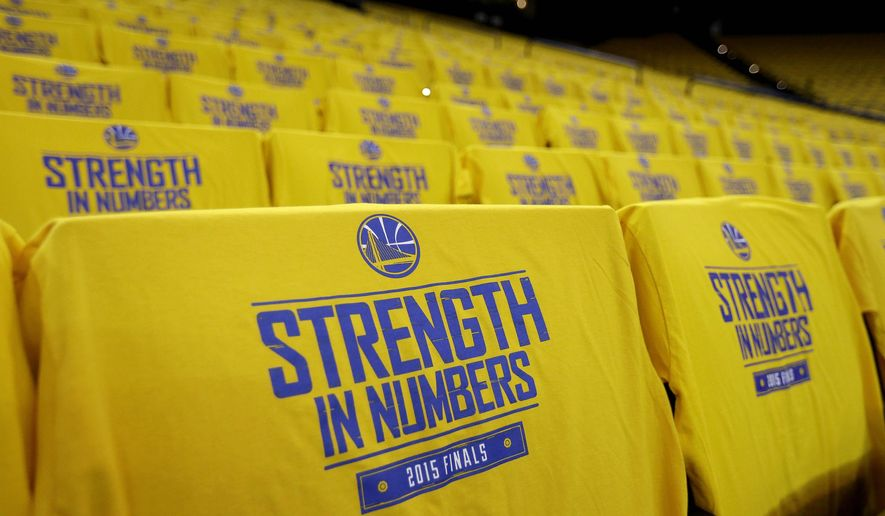 Golden State Warriors t-shirts are shown on seats at Oracle Arena before Game 1 of basketball's NBA Finals between the Warriors and the Cleveland Cavaliers in Oakland, Calif., Thursday, June 4, 2015. (AP Photo/Ben Margot)