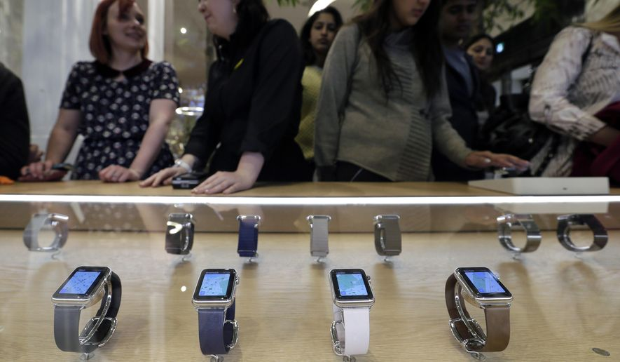 FILE - In this April 10, 2015 file photo, Apple Watches are on display in a store on Oxford Street in London. Two months after Apple began taking online orders for its newest product, the company on Thursday, June 4, 2015 said that it will begin selling some models in its retail stores in two weeks. Apple also says it's cutting through a backlog of online orders, with most watches ordered by end of May shipping within two weeks. (AP Photo/Tim Ireland, File)