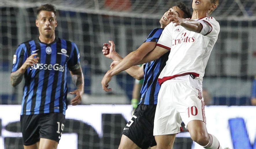 AC Milan's Keisuke Honda, right, and Atalanta's Alberto Grassi jump for the header during a Serie A soccer match in Bergamo, Italy, Saturday, May 30, 2015. (AP Photo/Felice Calabro')
