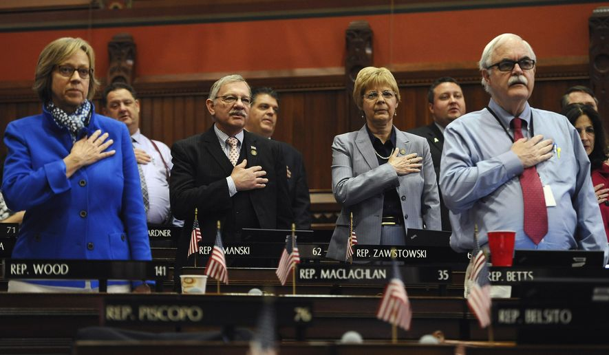 Connecticut State Representative recite the Pledge of Allegiance in the Hall of the House at the Capitol on the final day of session, Wednesday, June 3, 2015, in Hartford, Conn. (AP Photo/Jessica Hill)