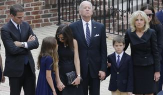Vice President Joe Biden, center, pauses alongside his family as they to enter a visitation for his son, former Delaware Attorney General Beau Biden, Thursday, June 4, 2015, at Legislative Hall in Dover, Del. Standing with Biden are his son Hunter, from left, granddaughter Natalie, daughter-in-law Hallie, grandson Hunter and wife Jill. Beau Biden died of brain cancer Saturday at age 46. (AP Photo/Patrick Semansky, Pool)