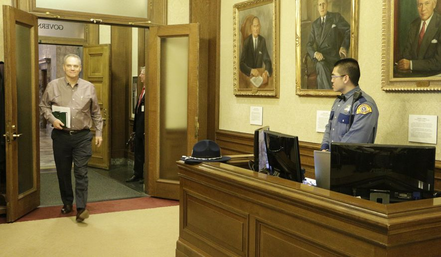 Democratic Rep. Ross Hunter walks into the governor's office for a budget meeting, Thursday, June 4, 2015, in Olympia, Wash. Washington lawmakers are in the midst of a second special session as they try to reach agreement on a two-year state budget. (AP Photo/Rachel La Corte)