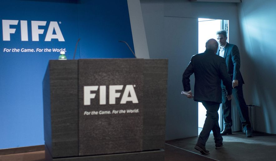 AP10ThingsToSee - FIFA President Sepp Blatter leaves after announcing his resignation from his position amid a corruption scandal at a press conference at the FIFA headquarters in Zurich, Switzerland, Tuesday, June 2, 2015. Blatter promised to call for fresh elections to choose a successor. (Ennio Leanza/Keystone via AP)