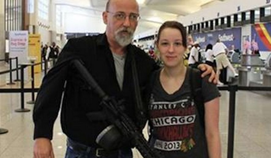 Jim Cooley, a Georgia open-carry activist, turned a few heads Tuesday as he carried his loaded AR-15 through the main terminal of Atlanta International Airport. (WSBTV)
