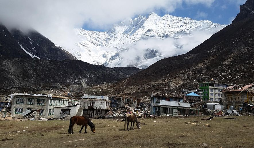 "This photo provided by Smithsonian Channel shows the ruins of Kanjin Gompa, a village in the Langtang Valley destroyed by a landslide in a scene from the documentary, ""Nepal Quake: Terror on Everest,"" a one-hour special airing on Monday, June 8, 2015, at 9 p.m. ET. (Kat Heldman/Smithsonian Channel via AP)"