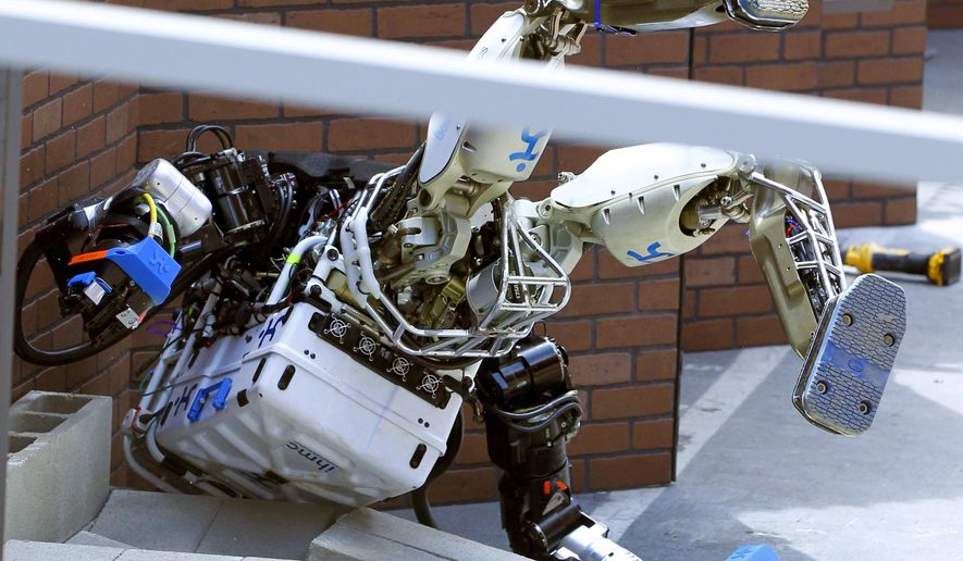 Robot Running Man from the Florida Institute for Human and Machine Cognition takes a tumble during the competition in the U.S. Defense Advanced Research Projects Agency Robotics Challenge in Pomona, Calif., Friday, June 5, 2015. (AP Photo/Alex Gallardo) ** FILE **