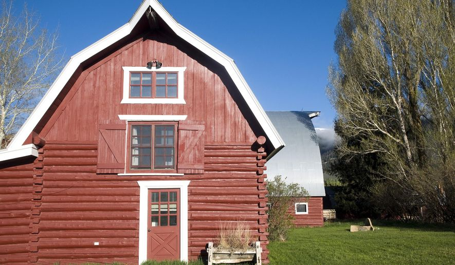 This photo taken on May 21, 2015, shows the Hardeman Barns, in Wilson, Wyo. Built in the mid-1900s, the Hardeman Barns were recently placed on the National Registry of Historic Places. The structures are on a 103-acre conservation easement preserving meadows just east of Wilson at the base of Teton Pass. (Bradly J. Boner /Jackson Hole News & Guide via AP)