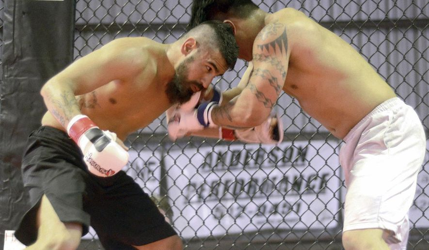 ADVANCE FOR SUNDAY JUNE 7 -  In this May 29, 2015 photo, Steven Gauna, left, fights Ryan Gabor at Havoc MMA1, at the Kodiak Island Fairgrounds in Kodiak, Alaska.  (Derek Clarkston/Kodiak Daily Mirror via AP) MANDATORY CREDIT
