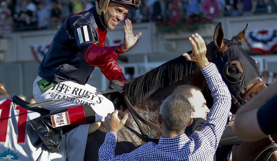"""FILE- In this June 7, 2014, file photo, jockey Joel Rosario, atop Tonalist, celebrates after they won the Belmont Stakes horse race in New York. """"I got lucky ... you need to have a clear trip. You need to get a position and if you are good enough you will do it. It's always a question of rhythm and being comfortable,"""" said Tonalist trainer Christophe Clement. On Saturday, American Pharoah will take on seven rivals in the Belmont in his bid to end a 37-year Triple Crown drought. (AP Photo/Matt Slocum, File)"""