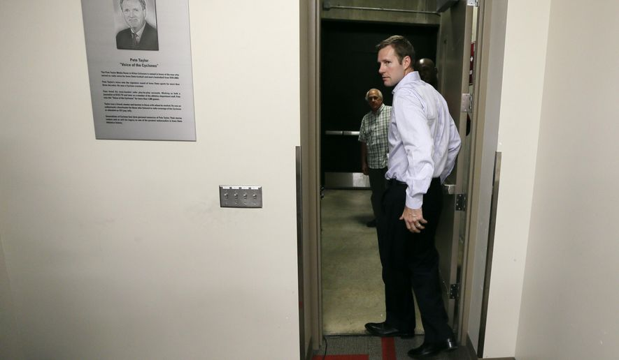 New Chicago Bulls head basketball coach Fred Hoiberg walks out the door after speaking at a news conference, Friday, June 5, 2015, at Iowa State University in Ames, Iowa. Hoiberg coached at Iowa State for the past five seasons. (AP Photo/Charlie Neibergall)